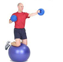 fitness exercise kneeling punches with support of swiss ball and medicine ball