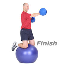 kneeling punches on swiss exercise ball finish
