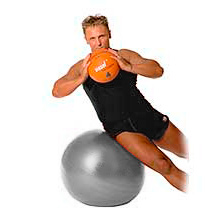 fitness exercise side flexion with support of a medicine ball