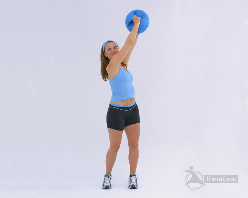standing reverse wood chop exercise with medicine ball